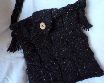 Classic hand knit black shoulder bag.