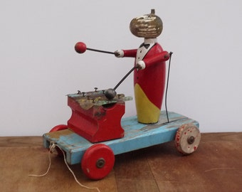 Toy pull wooden wheeled player Xylophone articulated 1920's, Collection wooden toy. Antique french Wooden Pull Toy