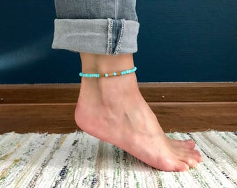 Turquoise-colored ankle strap with wooden beads