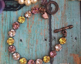 Swarovski crystal 8mm bracelet in sntiwue cooper.