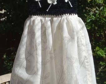 Delicate and floaty baby summer dress in black and cream crochet top with a georgette skirt