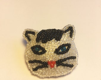Beaded black and white cat pin