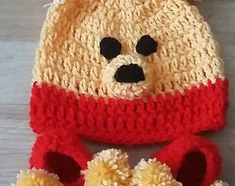 bear hat with pom poms and shoes