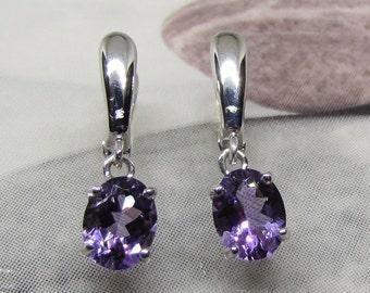 Silver earrings with dangling Amethyst