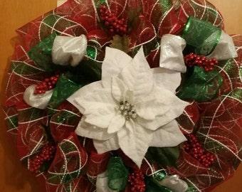 Beautiful Deco. Mesh wreath with a white poinsettia