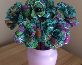 Hand made paper roses in painted jar