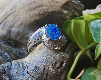 Australian boulder opal doublet and tanzanite size 6 ring