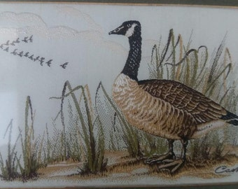 Cash embroidered picture; Canada Goose.
