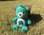 Green crochet lucky stuffed plush bear that can care