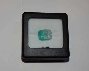 Paraiba Tourmaline Bi-color Gemstone, 14.98 carats, 5mm by 12mm by 12 mm thick