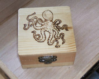 small wooden box with octupus detail