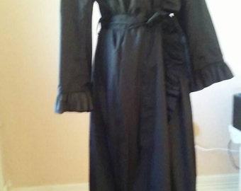 Vintage. 1960s-1970s black raincoat by Judy Scates for Raincheetahs