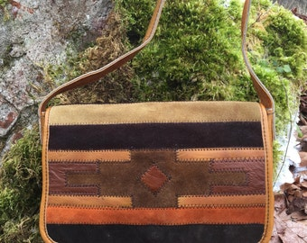 Small leather and suede southwestern-themed vintage shoulder bag