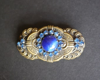 Pretty Czech pressed metal vintage brooch with dark blue cabochon and blue rhinestones