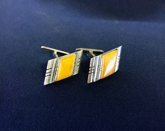 Silver cufflinks decorated with amber