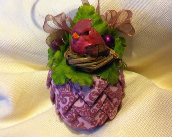 Mauve paisley print fabric pinecone ornament.