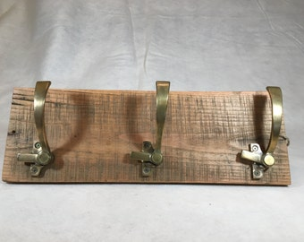 Recycled lumber coatrack with brass frig handles