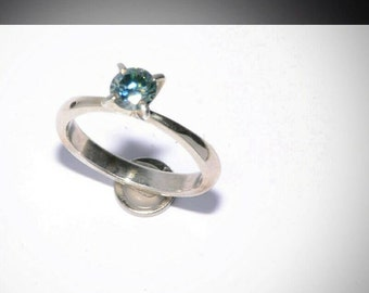 Silver ring with moissanite