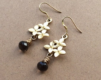 Gold plated cherry blossom dangle earrings with wire wrapped smoky quartz onion briolettes.