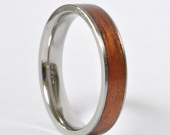 Bent Etimoe wood ring with stainless steel interior and sides