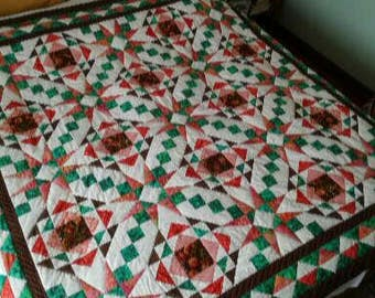 Handmade green white and pink quilted bedcover