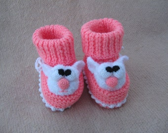 Knitted booties for baby. Booties with pink cat.