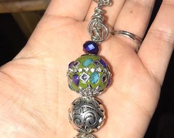Green silver purple keychain