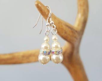 Beautiful ivory Swarovski crystal pearl drop earrings .. crystal rhinestone rondelle .. sterling silver wires.. bride ...prom.. bridesmaid