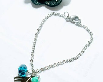 Silver tassel and Crystal