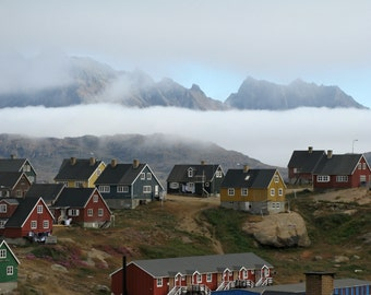 Fog bank over Inuit village, southeastern coast of Greenland