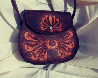 Western style two tone brown hand tooled and stitched original designed leather purse with magnetic clasp.
