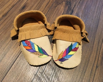 Painted feather moccasins