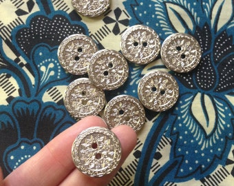 18 silver patterned buttons c1970s-80s