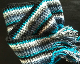 Crochet blue striped scarf.