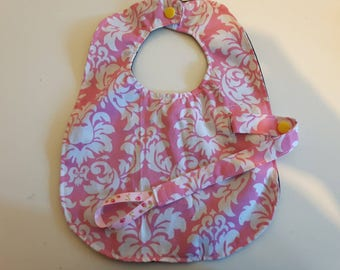 Waterproof bib with removeable pacifier clip