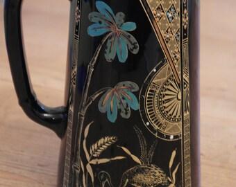 Victorian Gibson & Sons Palm Jug, Burslem, 1889. Glazed Earthenware, Painted and raised Enamel,Gilding.