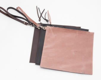 The daisy clutch by husk. keep everything you need together on the go