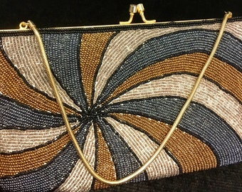 Vintage heavily beaded and embroidered evening bag with metal clasp and gold chain strap