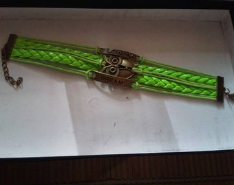 Bracelet has green neon with OWL connector.