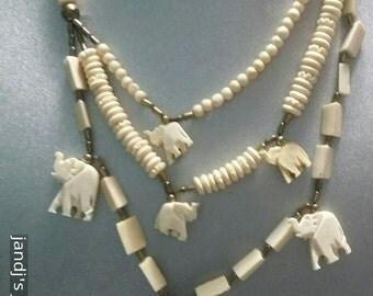 Elephant carved bone vintage necklace trunk up