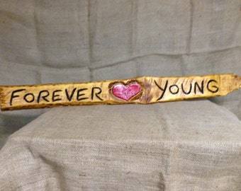 Chainsaw Carved Forever Young Sign