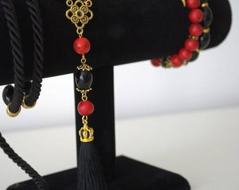 Long beaded red and black necklace