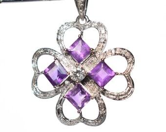 Amethysts and diamonds pendant