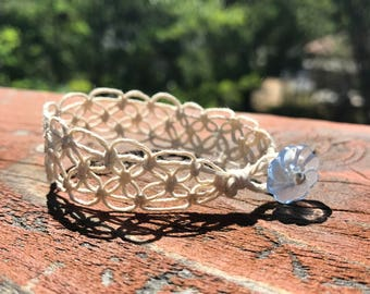 Lacy White Hemp Bracelet with Blue Flower Button