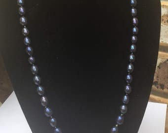 Necklace. Knotted Black AA grade pearls, with a silver clasp