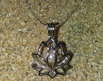 Lotus cage and necklace