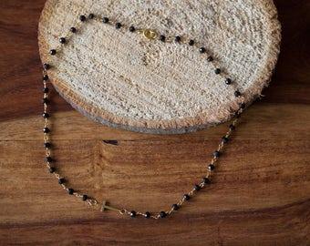 Necklace with cross x black onyx