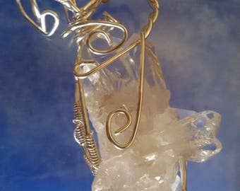 Beautiful pendant in rock crystal prisms