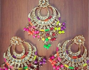 Long Phulkari kundan chandbali earrings and mangtikka teeka tika with red meenakari work and multi colour neon beads.