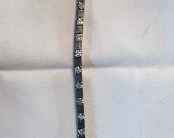 Tennis bracelet with 28 diamonds, black gold and rhodium plate white